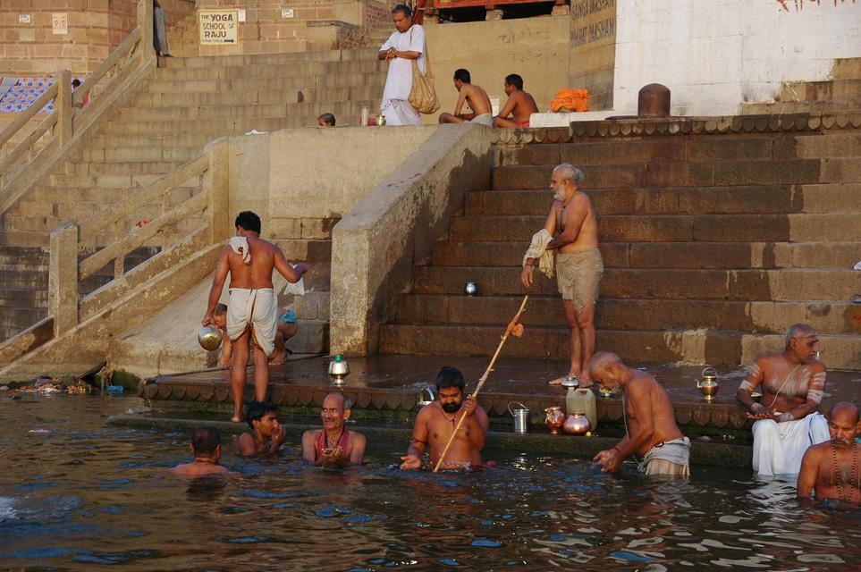 Varanasi or benares hindu men taking a bath in the holy ganges river